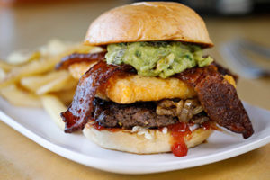 tempura-fried sharp white cheddar, grilled onions, candied bacon, guacamole, lettuce, ketchup