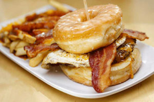 bacon, cheddar, egg*, onion, 2 glazed donuts as the bun