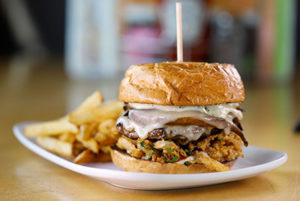 Not your mamas burger on a plate with fries