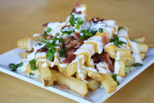 loaded fries with sour cream and bacon bits