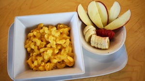 Mac and Cheese with apple slices on a plate