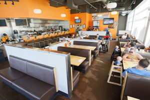 Dining area inside Crave restaurant in Highlands Ranch, CO