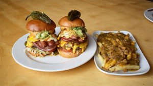 two cubano burgers and fries