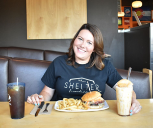 A member of the Shelter Foundation enjoying a burger and shake