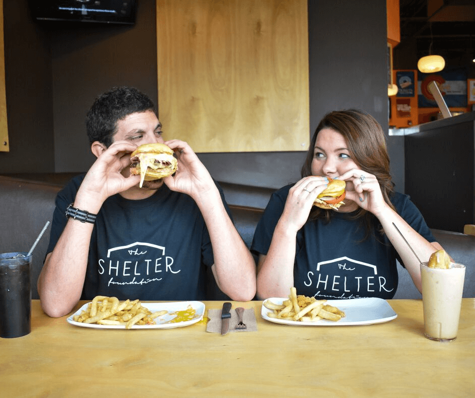 Two members of the Shelter Foundation enjoying a Crave Real Burger